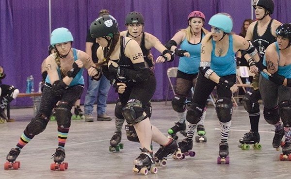Heart Mountain Wyoming Wreck on Wheels' Illuminaughty (center) — real name Siina Swanson, of Powell — looks to block a Wild West Wreckers player during a bout Saturday at the Riley Arena Center in Cody. Heart Mountain won 191-182.