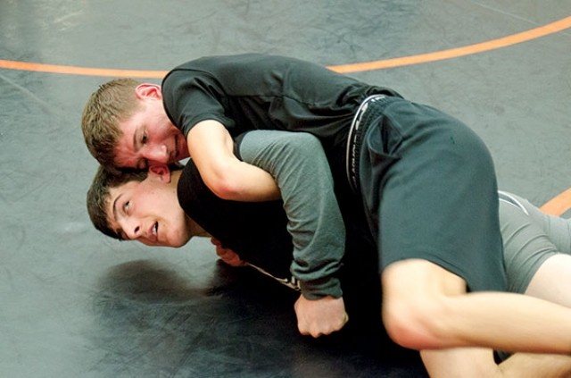 Noah Wozney works from top position against Dylan Rood during a drill in the Powell High School wrestling room recently. The Panthers open their season tonight (Thursday) against Kelly Walsh.