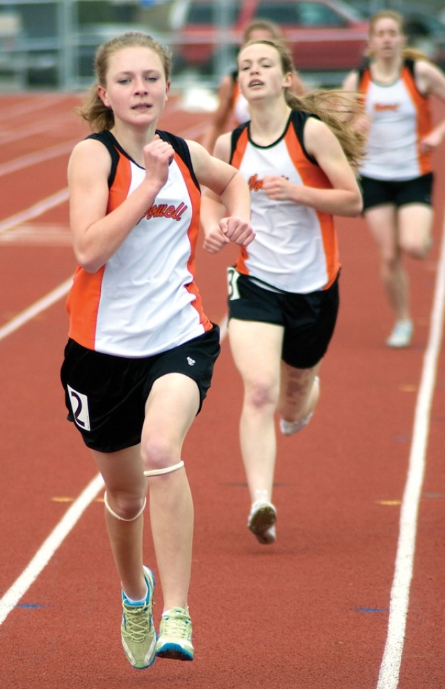 Sierra Morrow leads teammate Tess Mitchell to the finish line in the girls' 1600 on Friday in Cody. The pair were part of a 1-2-3-4 finish for the Panther girls.