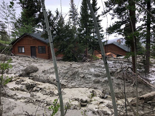 Shifting earth and sliding mud and debris have split apart Charlie and Jamie Cooley's cabin, pictured here on Wednesday. Photo courtesy Charlie Cooley