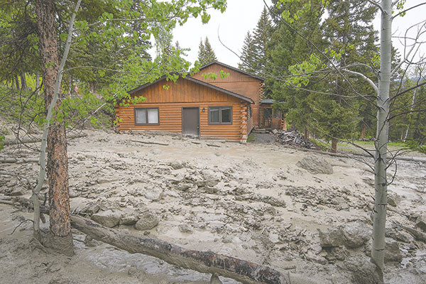 Mud slides past a cabin owned by Charlie and Jamie Cooley above Road XUX on Monday. Photo courtesy Dennis Davis