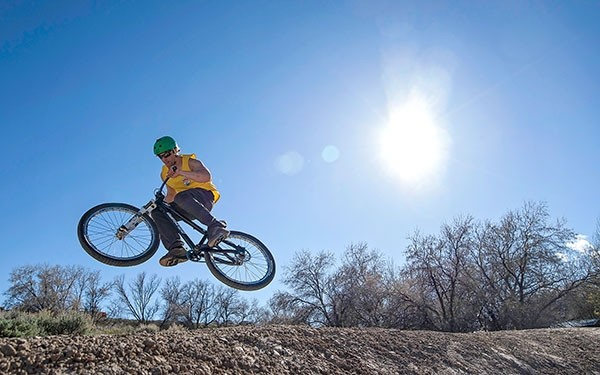 A rider catches air on the intermediate level jump on one of three jump lines at the Beck Lake Bike Park last year. Riders are asked to stay off the trails at the park when they are wet.