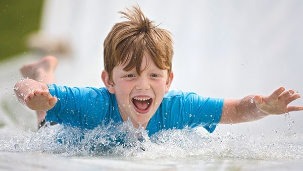 ZJ Moss is all smiles as he races down a water slide last summer at Homesteader Park. The Powell Recreation District will be sponsoring a full slate of activities for kids to enjoy this summer.