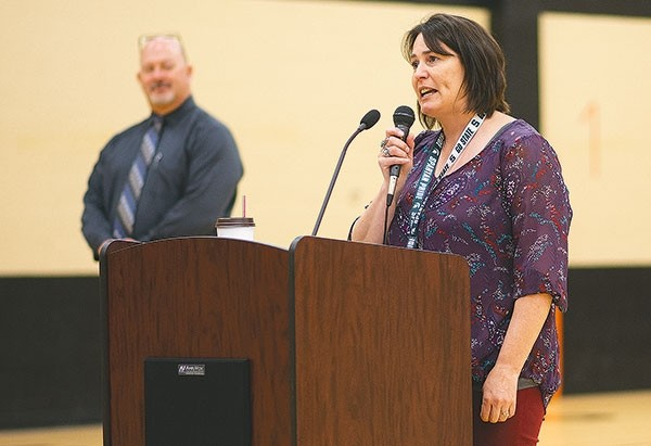 Powell Middle School science teacher Necole Hanks gets emotional as she speaks to an assembly commemorating her being named the Park County School District No. 1 Teacher of the Year on Monday morning. Powell Middle School Principal Jason Sleep looks on in the background.