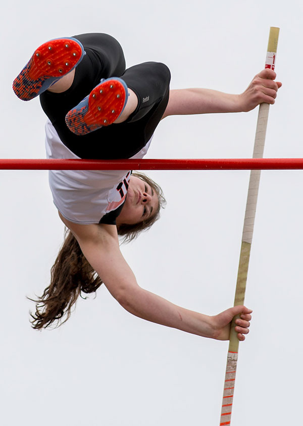 Powell High School senior Maddy Hanks clears the pole-vault bar Friday at the 3A West Regional Track Meet, held at Panther Stadium. The Lady Panthers finished second out of eight teams and are sending 20 athletes to state. Tribune photo by Don Cogger