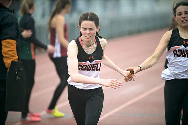 Powell senior JuliaKay O'Neill takes the baton from teammate Sabrina Shoopman Saturday during the 4x400 relay at the 3A West Regional Track Meet. The relay team of Brea Terry, Maddy Hanks, Shoopman and O'Neill finished third. Tribune photo by Carla Wensky