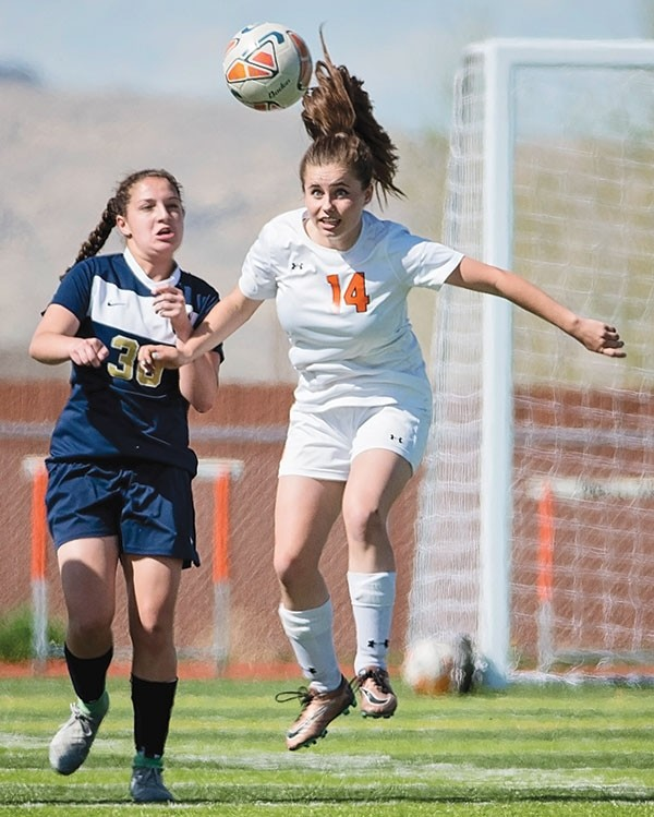 Lady Panther Sadie Wenzel heads the ball away from Cody's Torie Schutzman on Tuesday at Panther Stadium. The No. 1-ranked Fillies held off a determined Powell team for a 2-1 win.