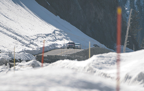 Cars pass through Sylvan Pass where the danger of avalanche is high. Superintendent Dan Wenk said if an avalanche occurs, it could take a day to reopen the road.