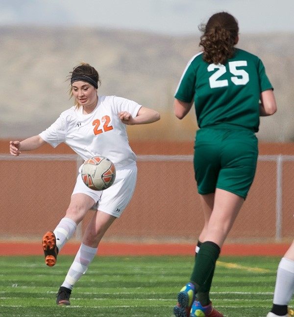 Lady Panther Jalie Timmons makes a play on the ball during the season-opening game against Pinedale in March. The Lady Wranglers played Powell to a 2-2 tie in the rematch in Pinedale Saturday.