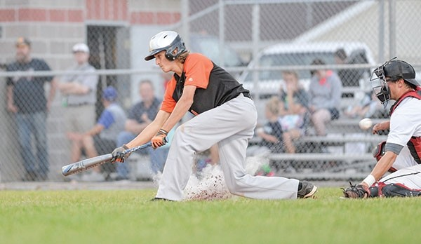Powell Pioneer Nate Brown attempts to lay down a bunt during a game last season. The Pioneers opened the 2018 season Sunday, dropping a pair of games on the road at Belgrade.