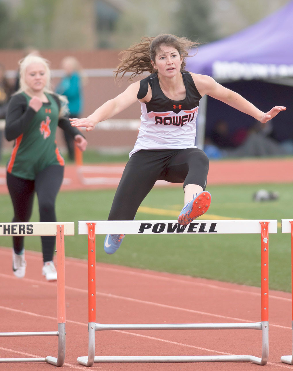 Lady Panther Maddy Hanks competes in the 300 meter hurdles at the 3A West Regionals in Powell early this spring. Hanks was given the L.A. Kohnke Most Deserving Award for her efforts this season.