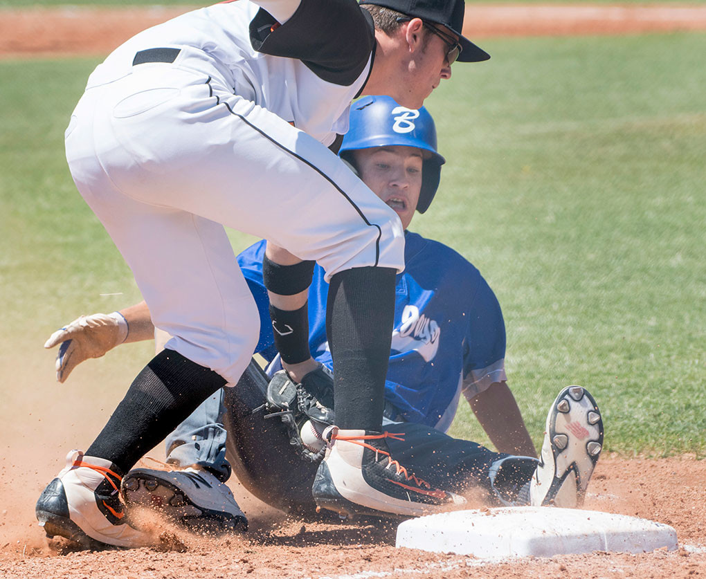 Pioneers third baseman Cameron Schmidt tags out a Billings runner Saturday at American Legion Field. The Blue Jays swept both games of a doubleheader.