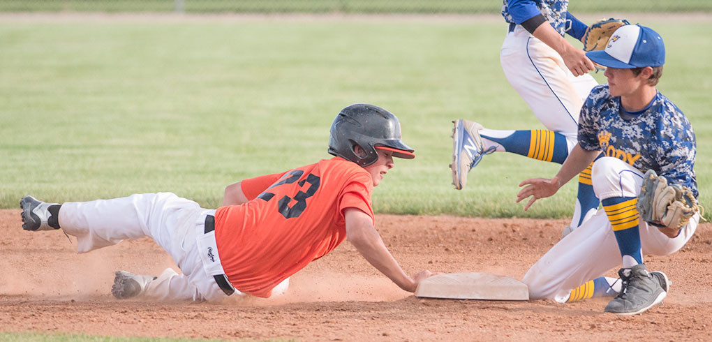 Pioneer baserunner Mason Marchant slides safely back into second base on a pickoff attempt Monday against the Cody Legion B team. The Pioneers lost both games of a doubleheader by a combined two runs, 5-4 and 9-8.