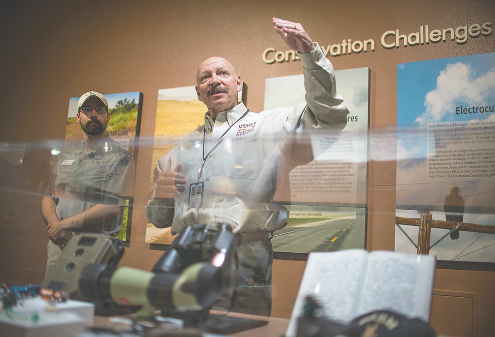 Dr. Charles R. Preston, senior curator of natural science and founding curator of the Draper Natural History Museum and Raptor Experience, introduces members of the staff while speaking at a soft opening of the Monarch of the Skies exhibit on June 7.