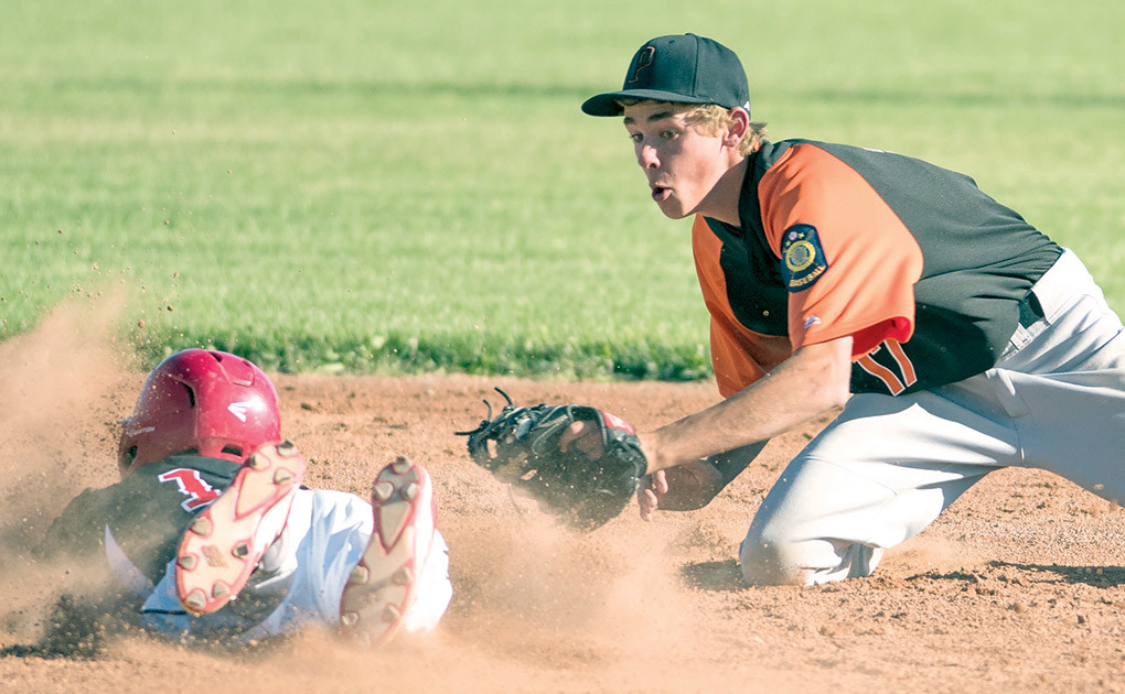 Pioneers shortstop Jesse Brown applies the tag to Lovell's Jess Wambeke Tuesday night at Legion Field in Cowley after Wambeke tried to stretch a single into a double. Wambeke was called out on the play.