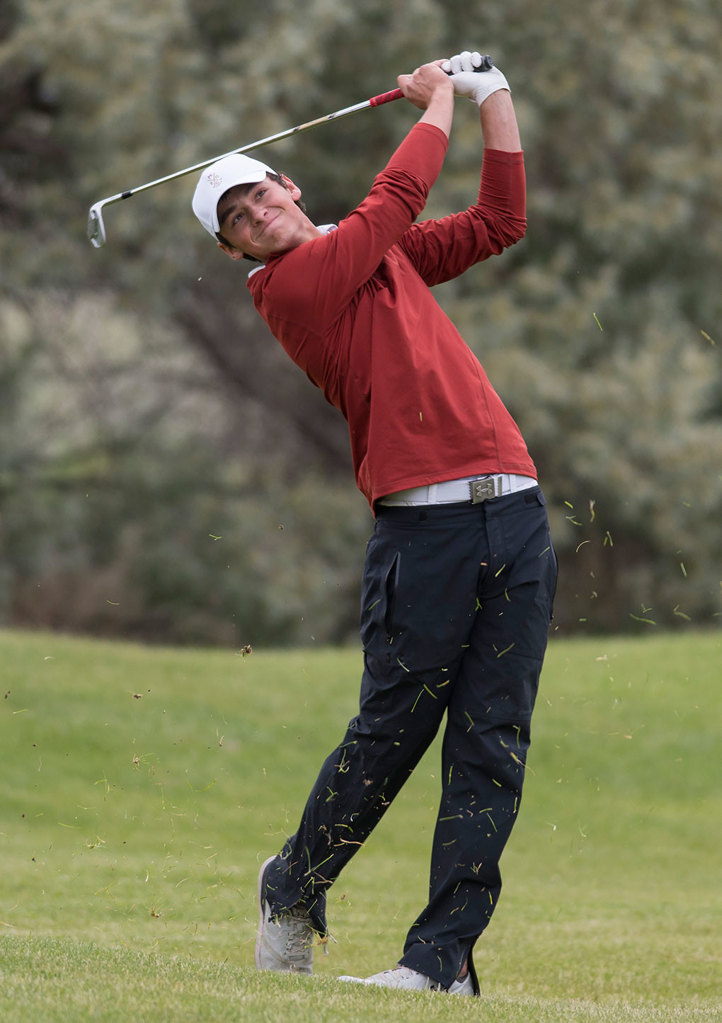 Pinedale's Jordan Costello — a member of the University of Utah golf team — tracks his approach shot Friday during the 2018 Wyoming State Match Play tournament at Powell Golf Club. Costello finished in the money in the Championship Flight's consolation bracket.
