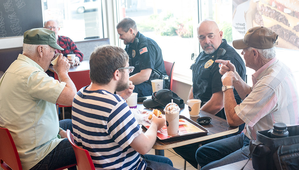 Powell Police Chief Roy Eckerdt (second from right) and Officer Kade Richmond visit with (from left) Jack McDonald, Ike Roberts, Wade Owen and Dave Johnson at Coffee With a Cop on Thursday at McDonald's in Powell.
