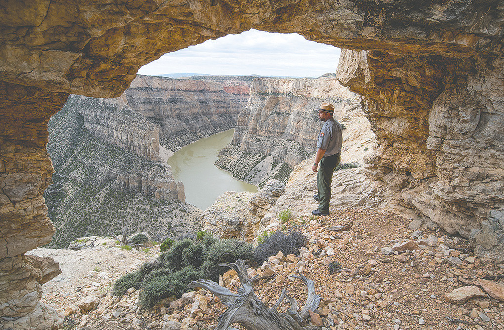 Todd Johnson looks for raptors while hiking near Devil Canyon in the Bighorn Canyon National Recreation Area. Johnson is the newest park ranger at the national park property near Lovell, coming to the service after retiring from the military.