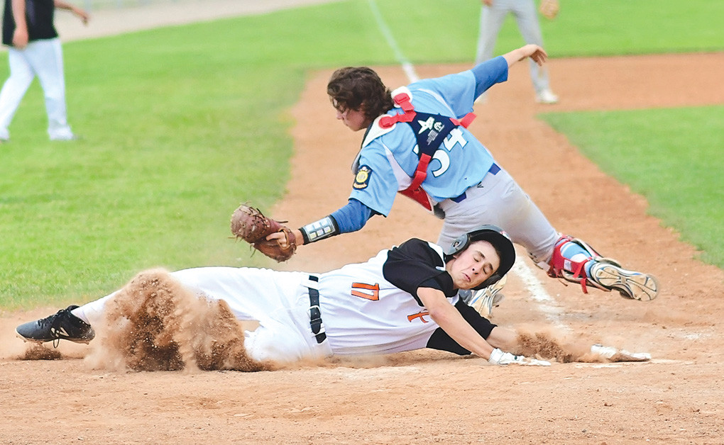 Pioneers baserunner Jesse Brown is tagged out on a close play at the plate by Laramie catcher Baden Jordan on Thursday against the Rangers. After losing 19-5 to Laramie, the Pioneers came back to sweep a doubleheader at Green River Saturday.