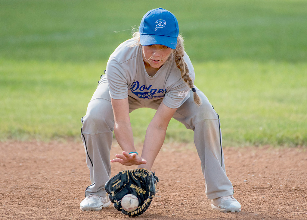 Dodgers shortstop Virginia Lohr fields a ground ball.