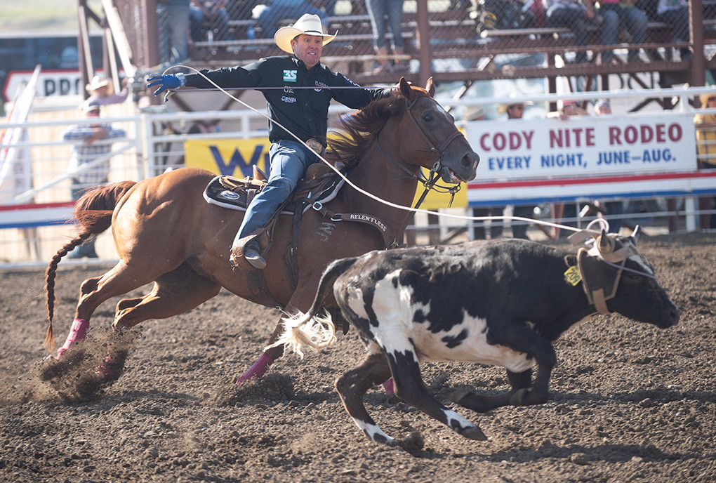 Trevor Brazile, along with heeler Patrick Smith (not pictured), makes a clean head catch during the July 4 Stampede Rodeo in Cody. The duo posted a 10.7 second run with a 5 second penalty for only catching one heel. Brazile holds the record for the most National Finals Rodeo world champion titles, with 23.