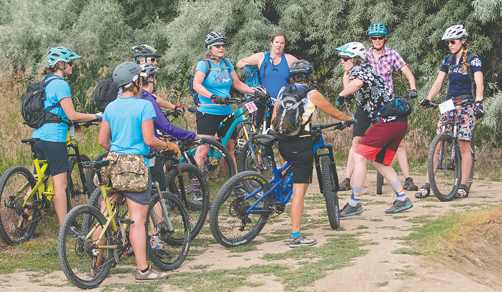 Professional mountain bike instructor Gretchen Reuning leads a group through a cornering seminar before using the pump track at the Beck Lake Bike Park in Cody Saturday. Thirty women attended the sold-out event.