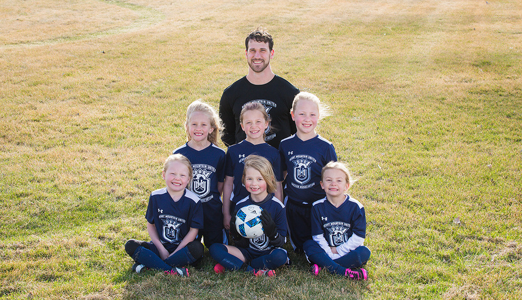 8U girls - Back row: Coach Kevin French; middle: Aspen French, Ily Williams and Charlie Eastman; bottom: Timber Eastman, RaeAnn Jackson and Rilee Rohrer.