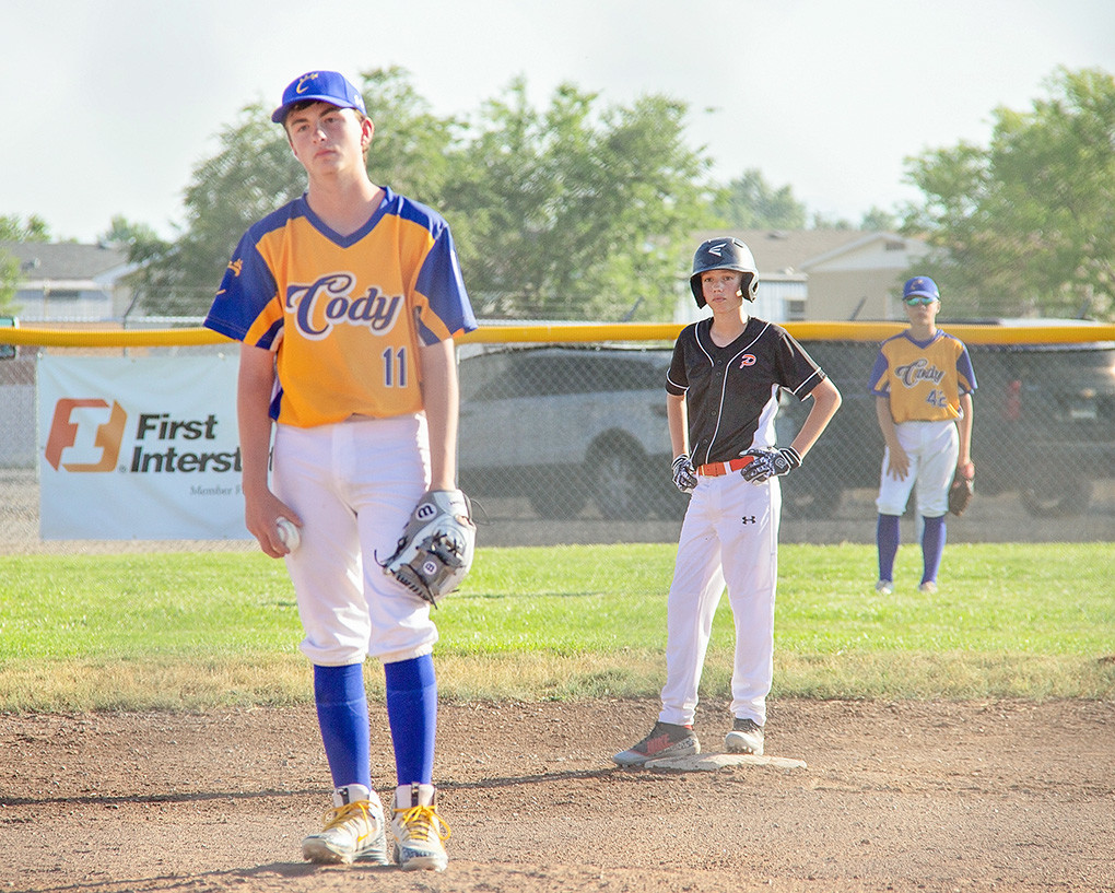 A dejected Cody pitcher's face tells the story, as Powell baserunner Jacob Gibson looks on from second. Powell beat Cody twice during the Battle at the Winds Tournament in Riverton, including an 8-1 beatdown in the championship game.