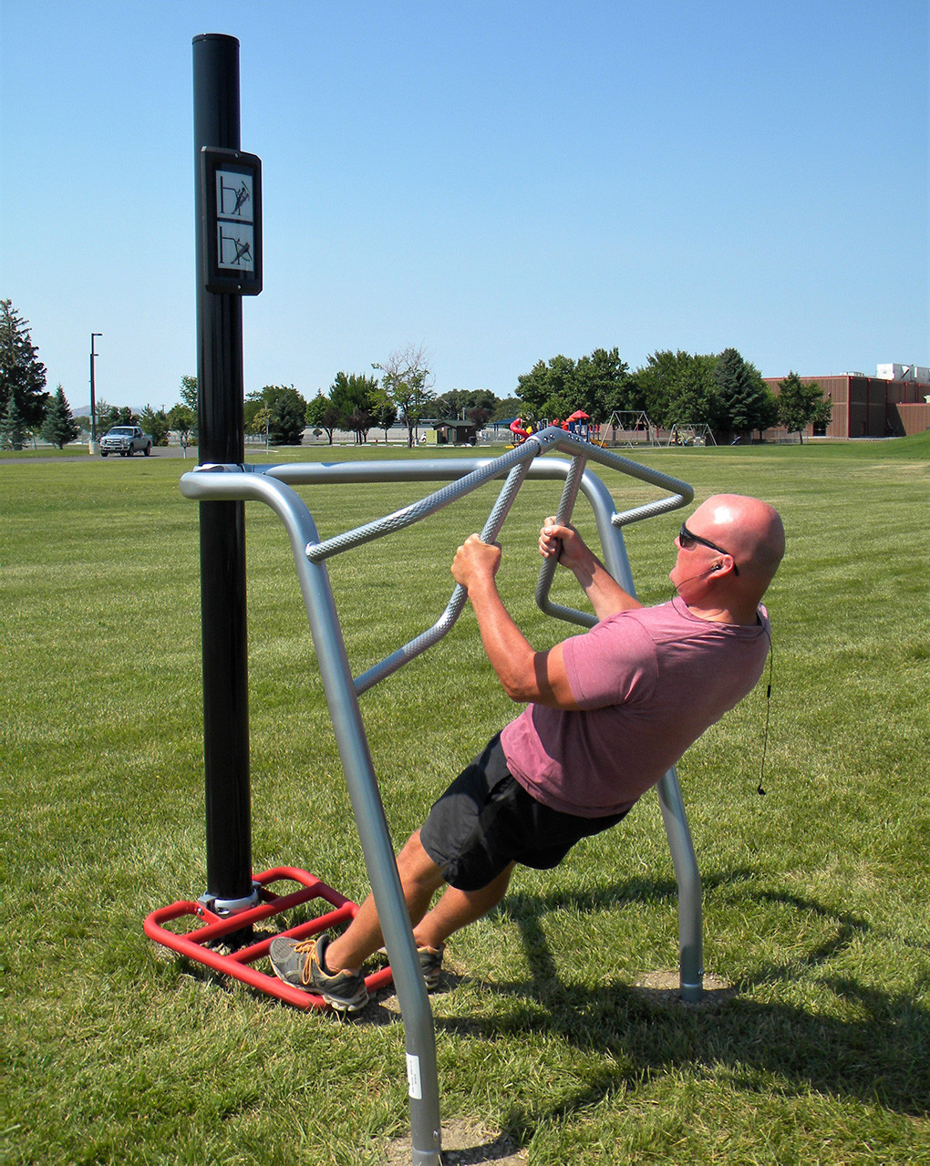 City of Powell employee Tim Jordan demonstrates how to use one of the fitness stations recently installed at Homesteader Park. There are five stations in all, each designed to work a different part of the body.