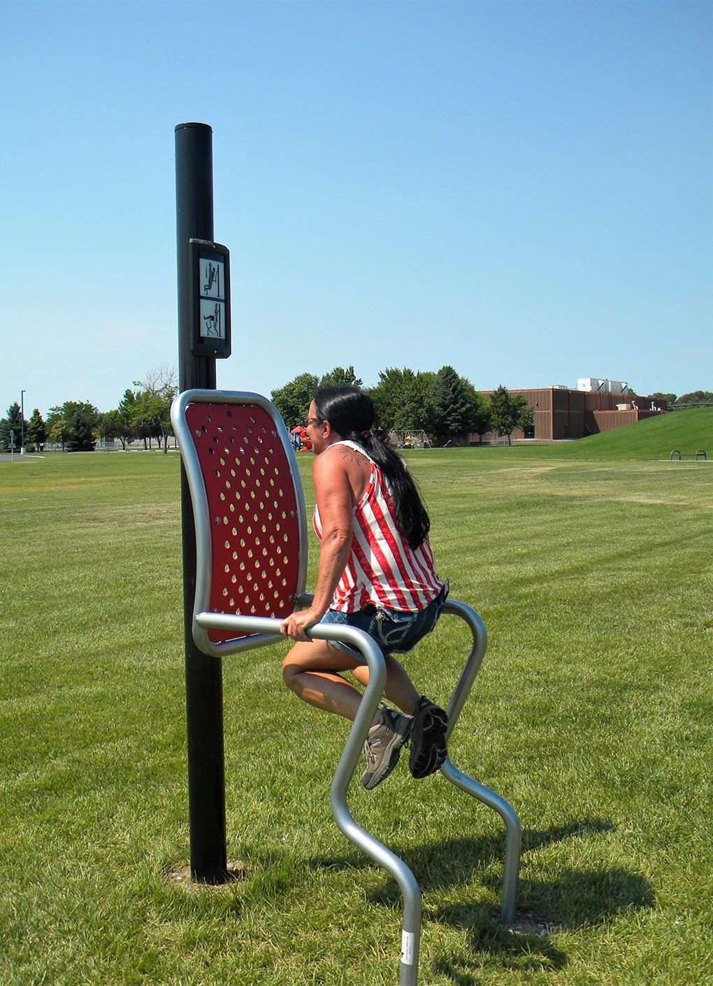 City of Powell employee Teresa Cheney shows good technique on the dip and leg raise station at Homesteader Park. The equipment is available free to the public during normal park hours, 7 a.m. to 11 p.m.