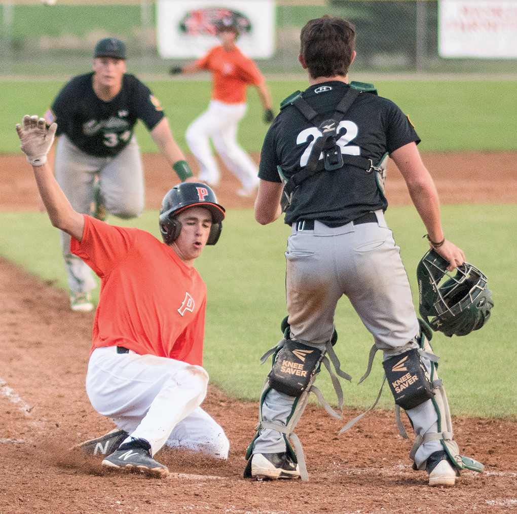 Pioneers shortstop Jesse Brown slides safely into home, scoring the game-winning run against Green River Tuesday at Ed Lynn Memorial Field. With the 7-6 win, Powell clinched the 4-seed heading into next week's district tournament in Lovell.