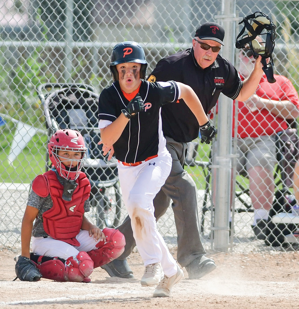 Powell catcher Jhett Schwahn sprints toward first base during Saturday's District 1 Championship game against Big Horn. Powell won the championship, 6-2.