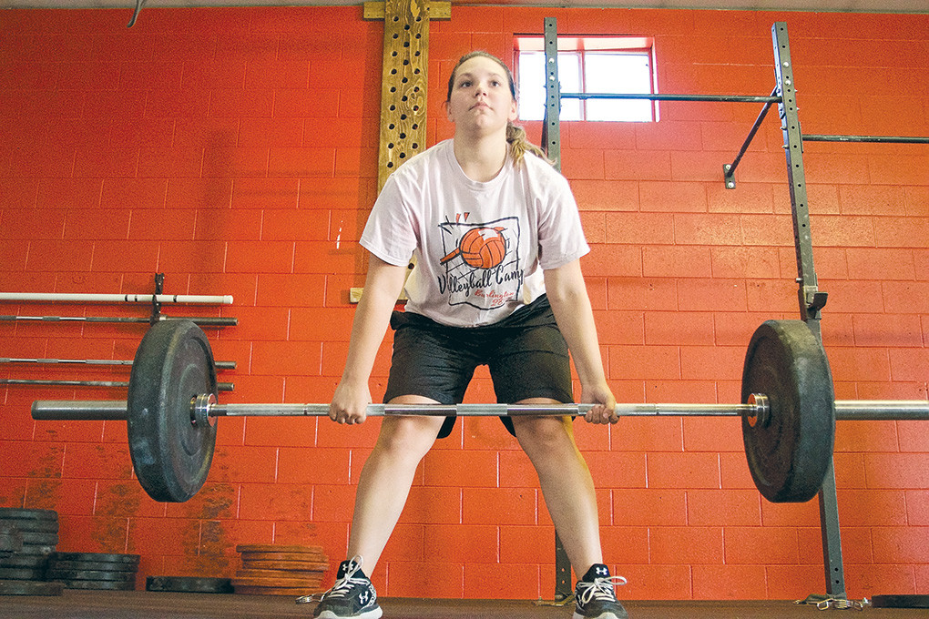 Delaney Neves of Burlington works on her deadlift technique at Freedom Fitness Gym, part of the Sports Performance Training program.