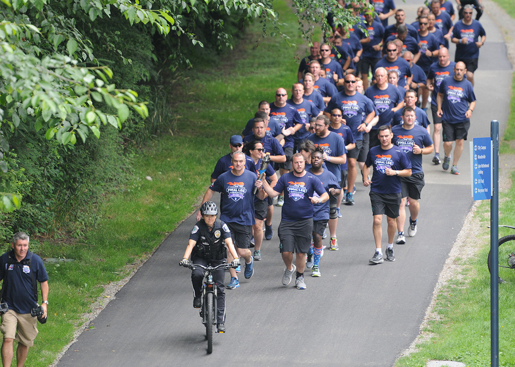 Powell Police Officer Matt Koritnik (the second runner in the far right-hand column) joined with law enforcement representatives from across the country to run the final leg of the Law Enforcement Torch Run to the recent Special Olympics USA Games in Seattle.