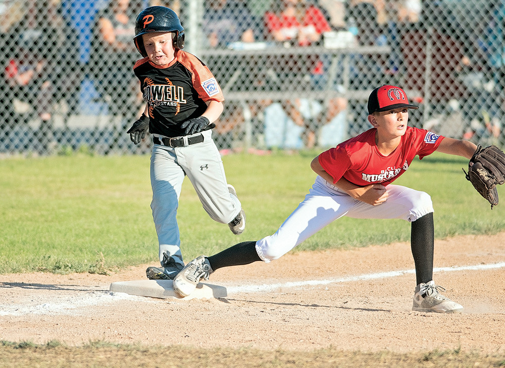 Powell baserunner Ryan Burres reaches first just behind the throw in a loss to Big Horn on Friday.