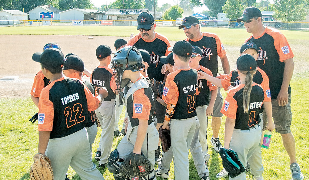 The Powell 10U All-Stars break a huddle before Friday's District 1 tournament game against Big Horn.