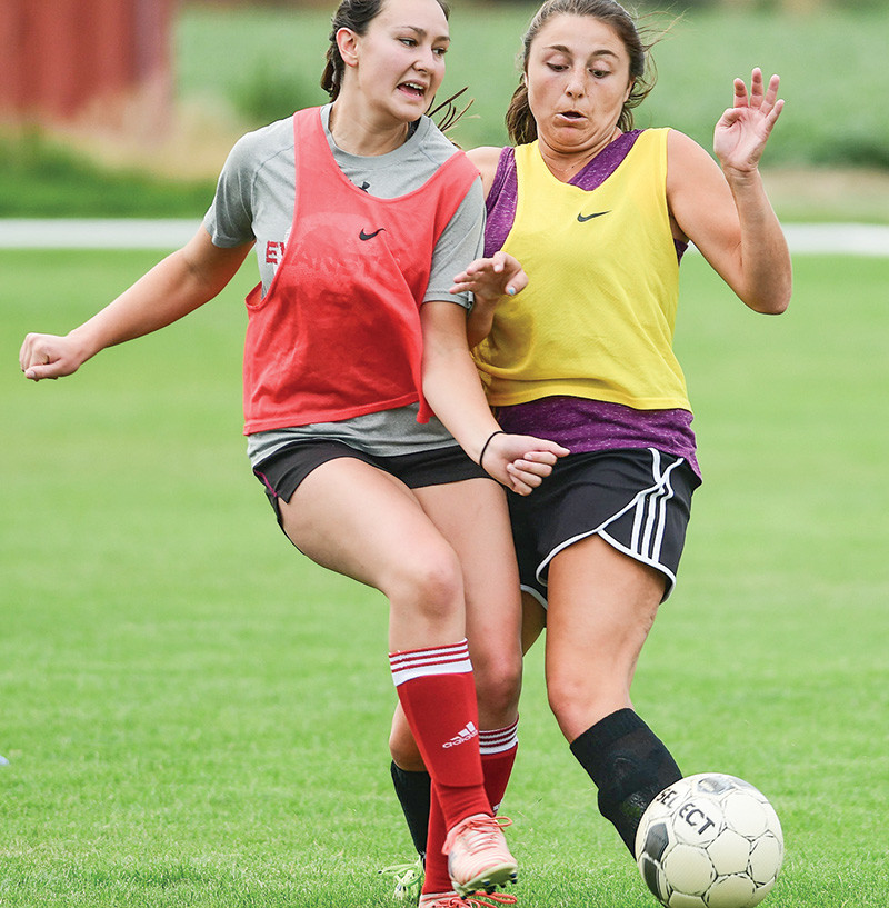 Lady Trapper Drew Groll (left) of Evanston, battles Powell's Abbie Hogan for possession of the ball during practice at Trapper Field on Friday. The Lady Trappers are looking to rebound from a winless season a year ago with a talented mix of returners and recruits.