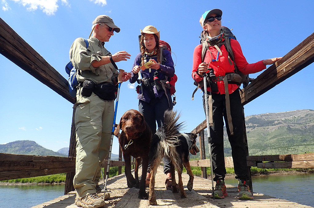 Scott Wolff of Duluth, Minnesota, visits with Virginia Schmidt (center) and Jessica Williams (right) after a chance encounter at a pack bridge at Hawk's Rest, along the Yellowstone River in the Thorofare.