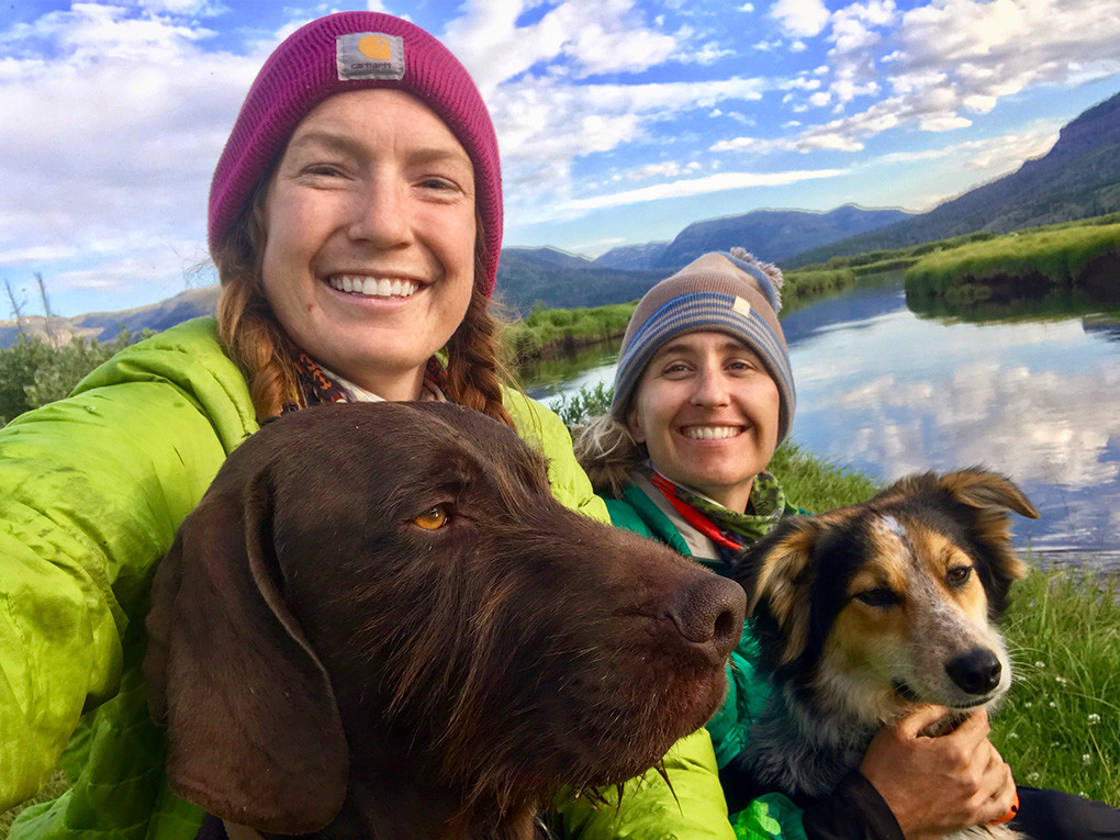 Virginia Schmidt (left), her friend Jessica Williams and their dogs Peter (left) and Penny pose for a selfie near their Day 4 campsite, on the Yellowstone River at Hawk's Rest, otherwise known as Bear Box Row.