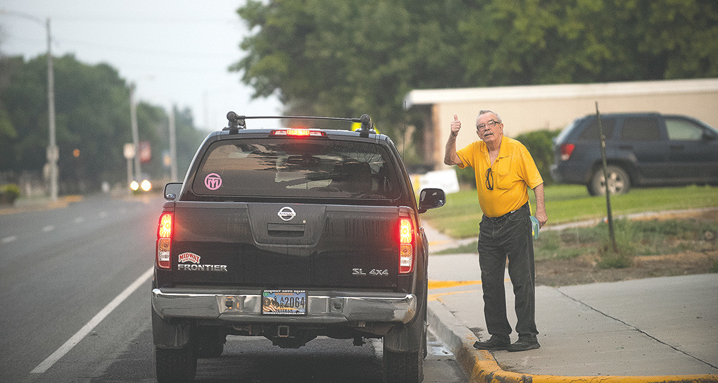 Hank Ramak gives a thumbs up after receiving a ride Friday morning in Byron, en route to see his longtime love Joyce Jackson at the Powell Valley Care Center. Ramak said he usually starts walking from his home in Byron around 6 a.m. and gets a ride from the first person to stop.