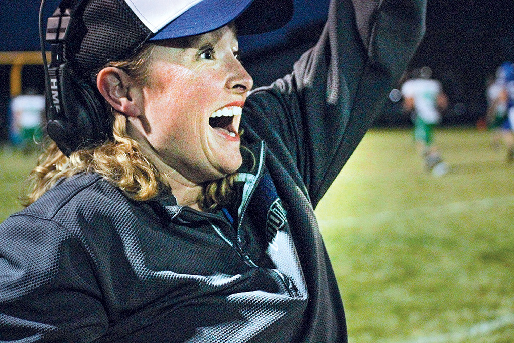 Lovell High School football coach Jeny Gardner celebrates on the sidelines during a game last season. Gardner made history in May when she was named the first female head football coach in the state of Wyoming, taking over the reins of the Class 2A Lovell Bulldogs. Gardner is taking over for former coach Doug Hazen, who stepped down from the position in May after nine seasons.