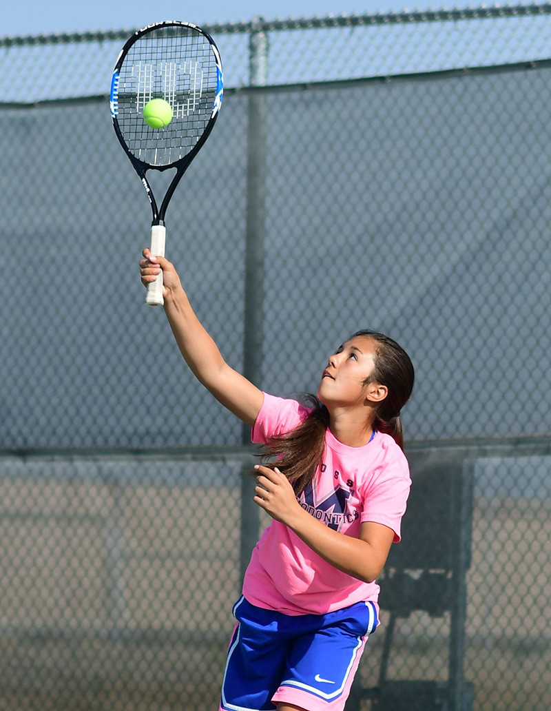 Lady Panther Kaili Wisniewski serves to a teammate during drills Saturday at the PHS courts. The Lady Panthers are looking to fill vacancies at the No. 1 and No. 2 singles positions, and the competition is tight.