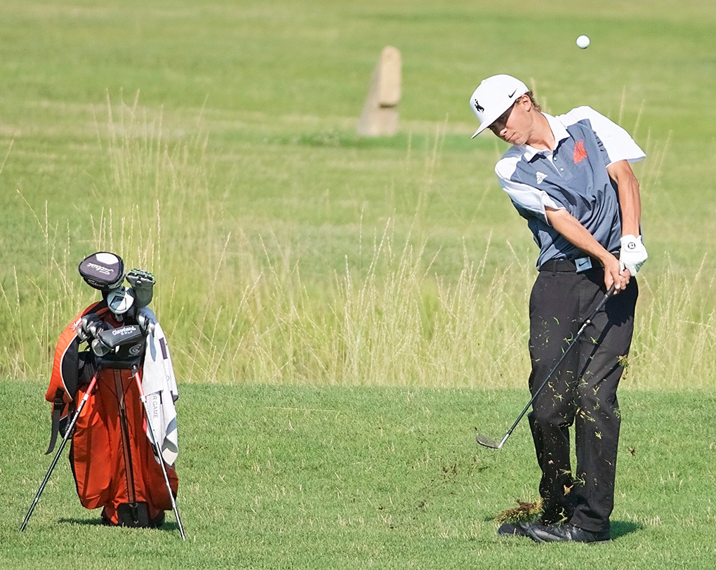 Panther senior Rob Sessions hits his approach to the ninth green during the Cody/Powell Invitational at the Powell Golf Club on Friday. Sessions carded rounds of 89 and 86, while the Panthers as a team finished sixth in the 13-team field.