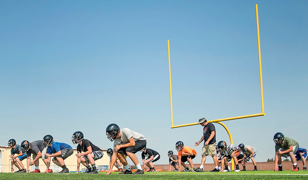 Panthers head coach Aaron Papich works with the linemen on Tuesday at Panther Stadium. This will be Papich's first year at the helm of the Panthers, following stints as an assistant in Casper and Riverton.
