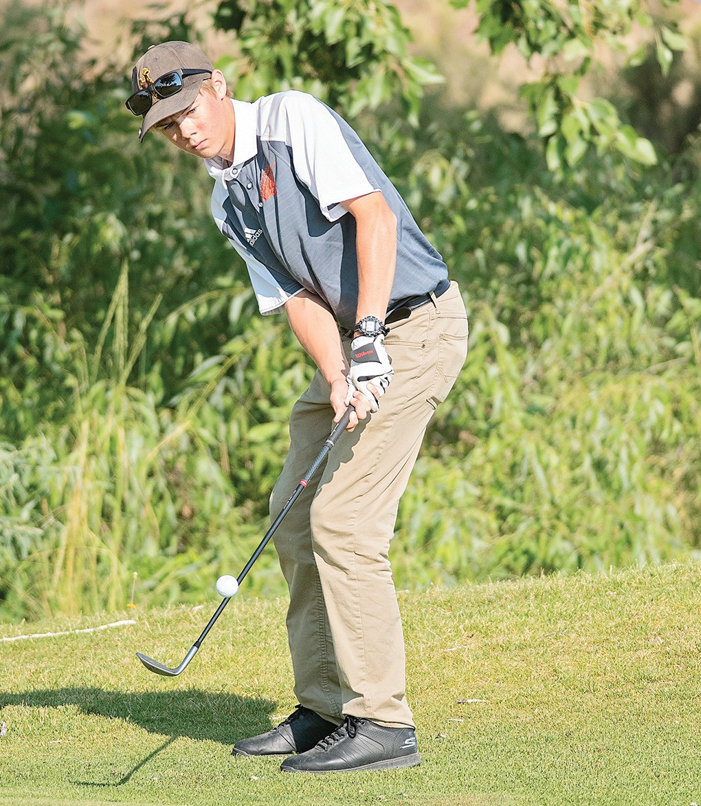 Panther golfer George Higgins chips onto the green during a tournament earlier this month at the Powell Golf Club. Higgins shot a 95 and a 97 at the Worland Invite over the weekend.