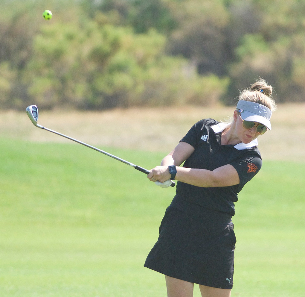 Lady Panther Mycah Wainscott hits her approach on hole No. 1 during the Cody/Powell Invite at the Powell Golf Club earlier this month. Wainscott carded a pair of 100-stroke rounds at the Worland Invite over the weekend.