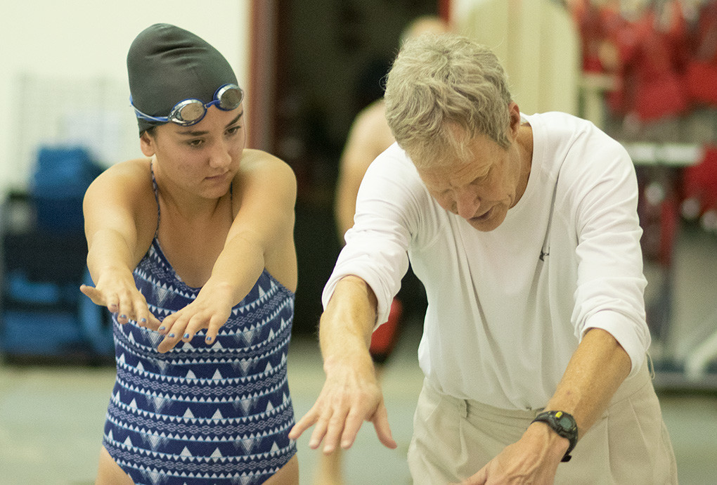 PHS girls' swim coach Bob Smartt works on technique with Lady Panther Anna Fuller Tuesday during practice at the Powell Aquatic Center.The Lady Panthers open their season Saturday at the Lander Invitational.
