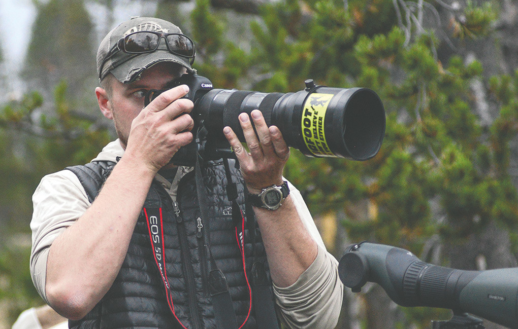Peter Mangolds works to get a shot of wildlife — with his Canon EOS 5D camera and 150-600mm Sigma zoom lens — last month in Hayden Valley at Yellowstone National Park.