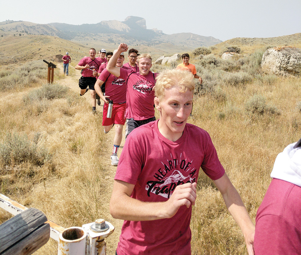 Hunter Kiser of the NWC wrestling team leads the pack down the trail from Heart Mountain on Saturday, Aug. 25.