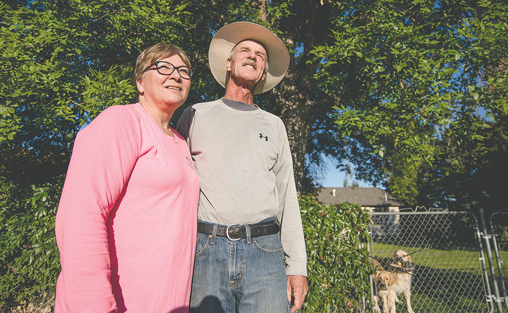 Tami and Kevin Lineback stand feet from where a 130-pound mountain lion was perched in a tree in their backyard Tuesday morning. Lineback shot the lion after checking with the Game and Fish and buying a tag for Hunt Area 20, where cougar hunting is allowed year-round.